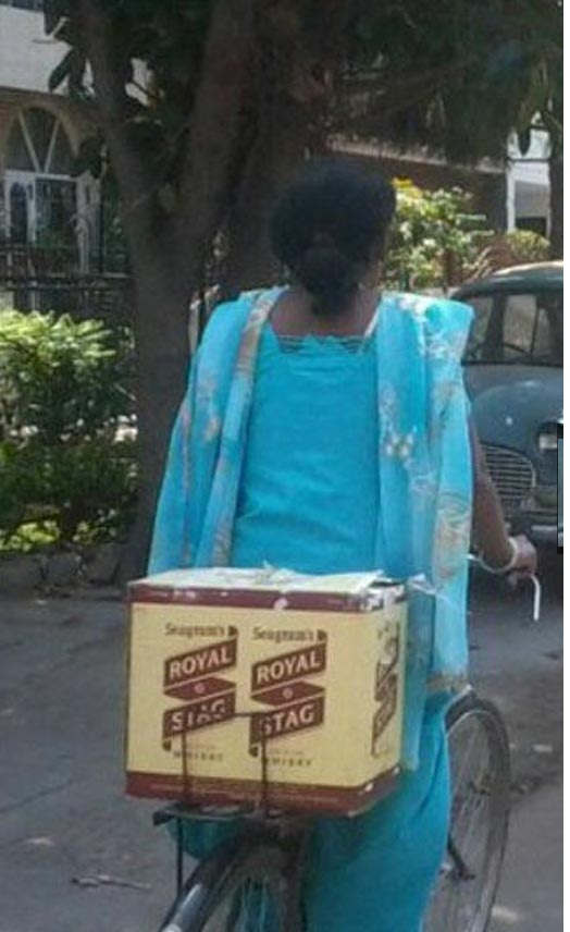 funny-indian-girl-carry-whiskey-on-cycle1