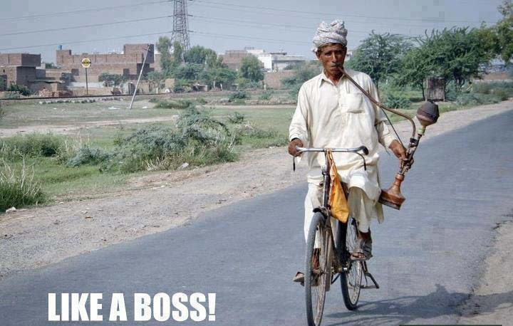 Like-A-Boss-Old-Man-Drive-A-Cycle-With-Big-Cigarette
