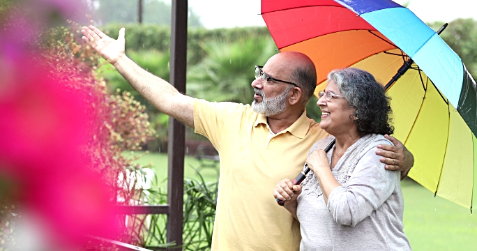 Senior couple enjoying in rain season, Delhi, India