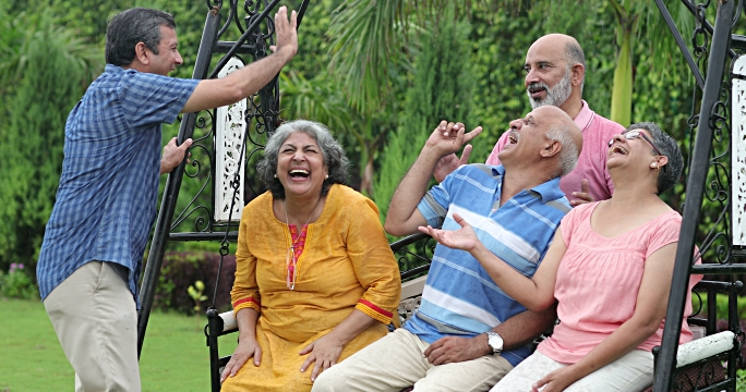 Senior men and senior women enjoying in the park, Delhi, India